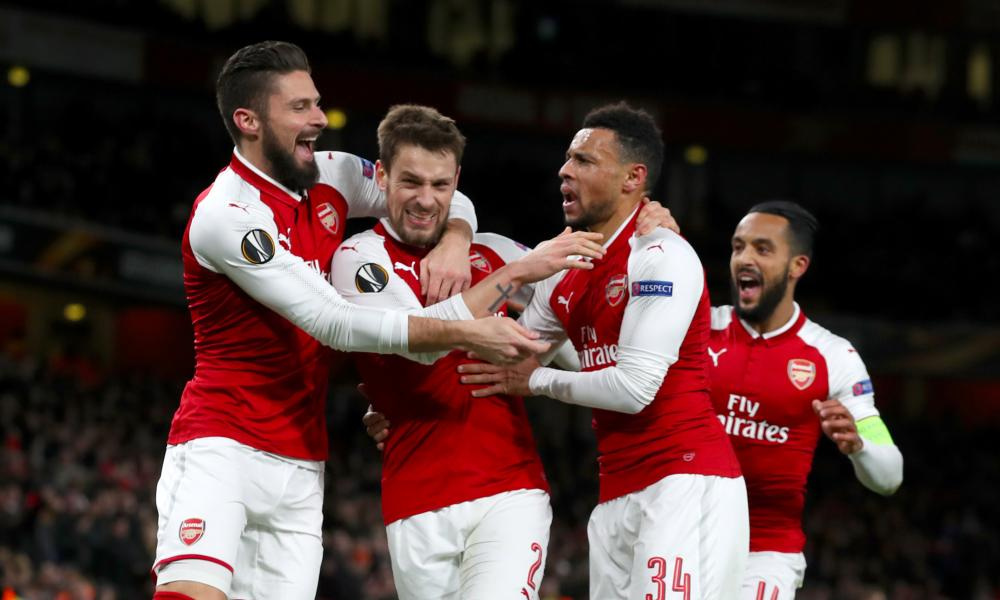 Arsenal's Mathieu Debuchy, centre, is congratulated on his goal by Olivier Giroud, left, Theo Walcott, right, and Francis Coquelin.