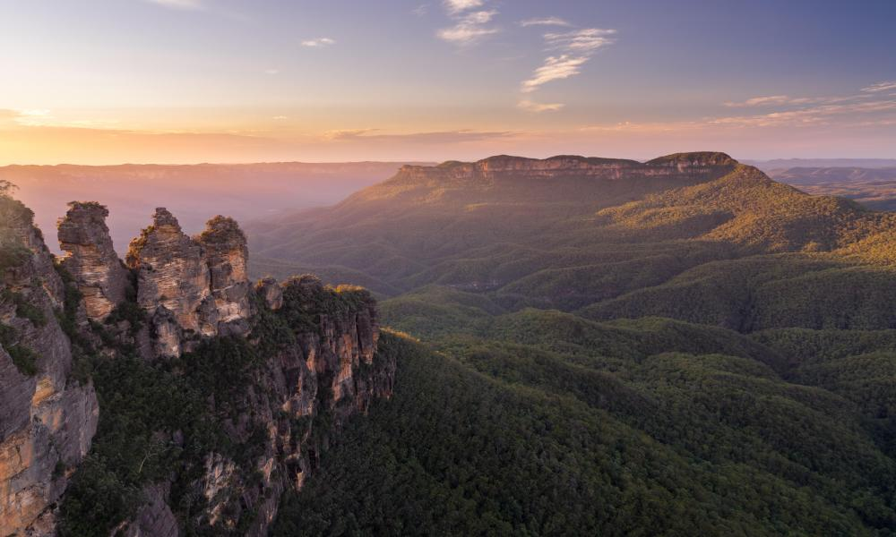 Golden early morning light on Mount Solitary with the famous three sisters in the foreground, Blue Mountains, NSW, Australia