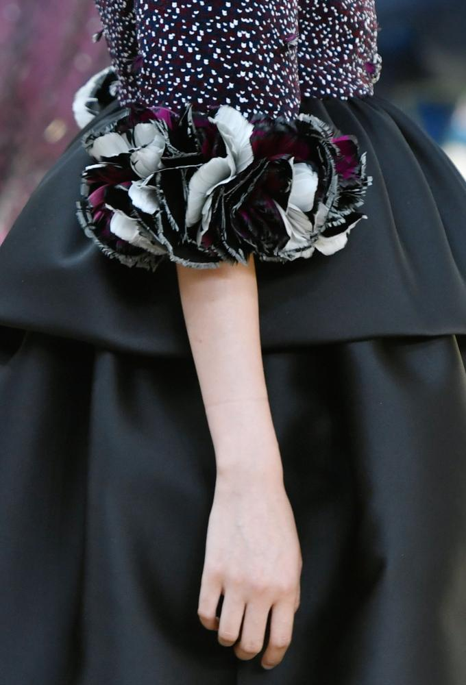 Feather-embellished sleeves at Chanel.