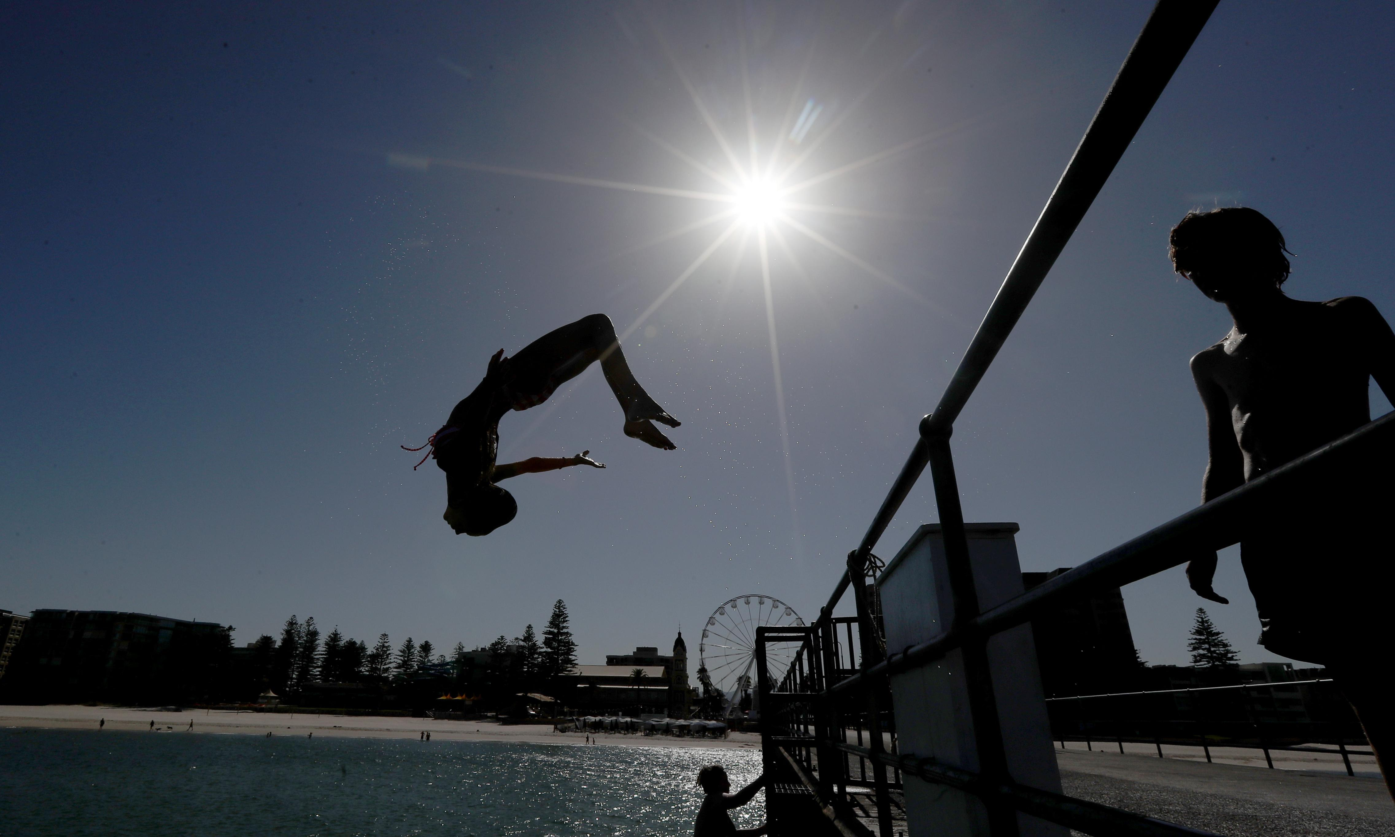 Adelaide breaks its all-time heat record, hitting 46.6C, in extreme Australia heatwave