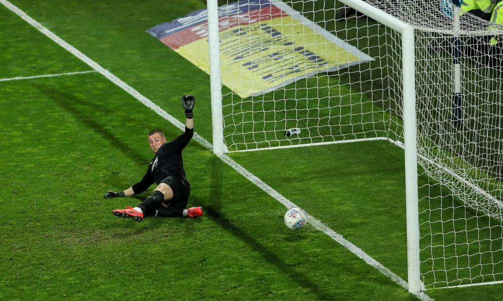 Tammy Abraham of Aston Villa scores the winning penalty off the legs of Baggies keeper Sam Johnstone.
