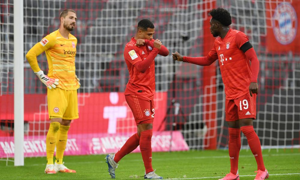 Bayern Munich's Serge Gnabry and Alphonso Davies (right)celebrate their fifth goal.
