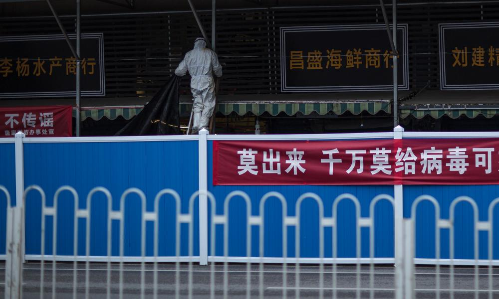 The shuttered Huanan Seafood Market in Wuhan, China being disinfected in March.