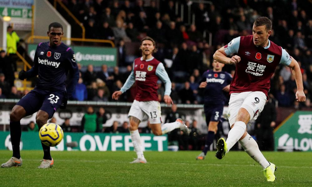 Burnley's Chris Wood scores their second goal.