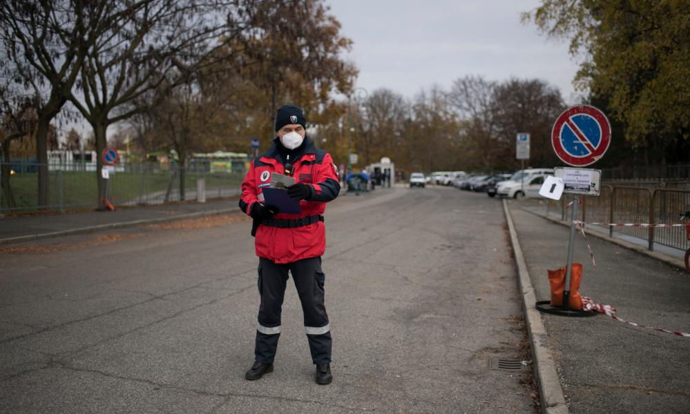Policeman wearing protective mask checks outside the Torino Esposizioni Temporary Hospital in Turin, Italy.