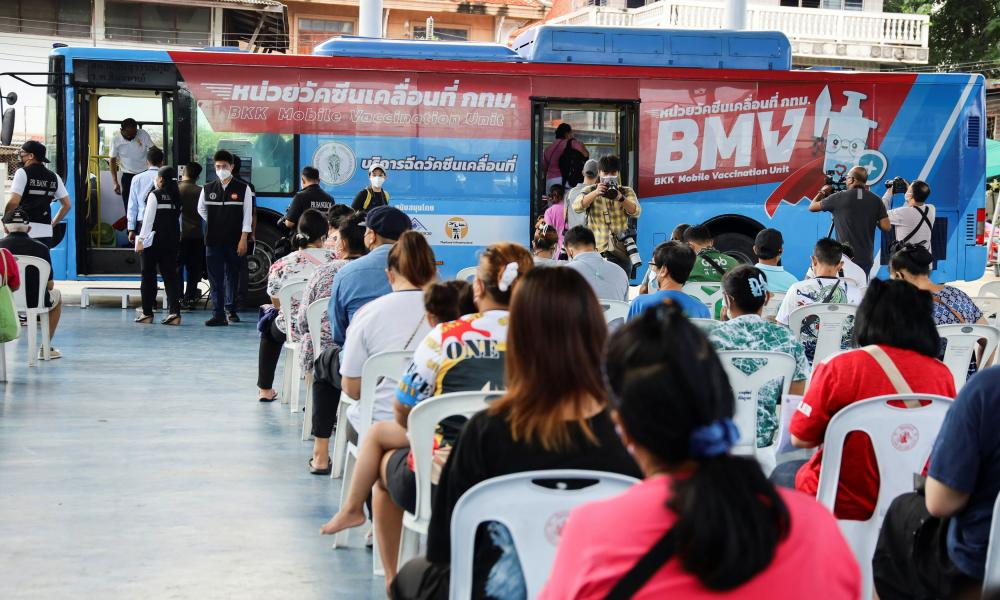 People wait in front of a coronavirus disease (COVID-19) mobile vaccination bus set-up to serve the elderly and disabled groups in Bangkok, Thailand, September 8, 2021. REUTERS/Juarawee Kittisilpa