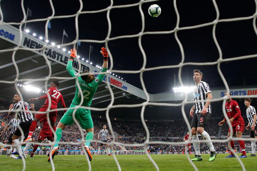 May 4: Divock Origi scores the late winning goal for Liverpool in their 3-2 victory at Newcastle.