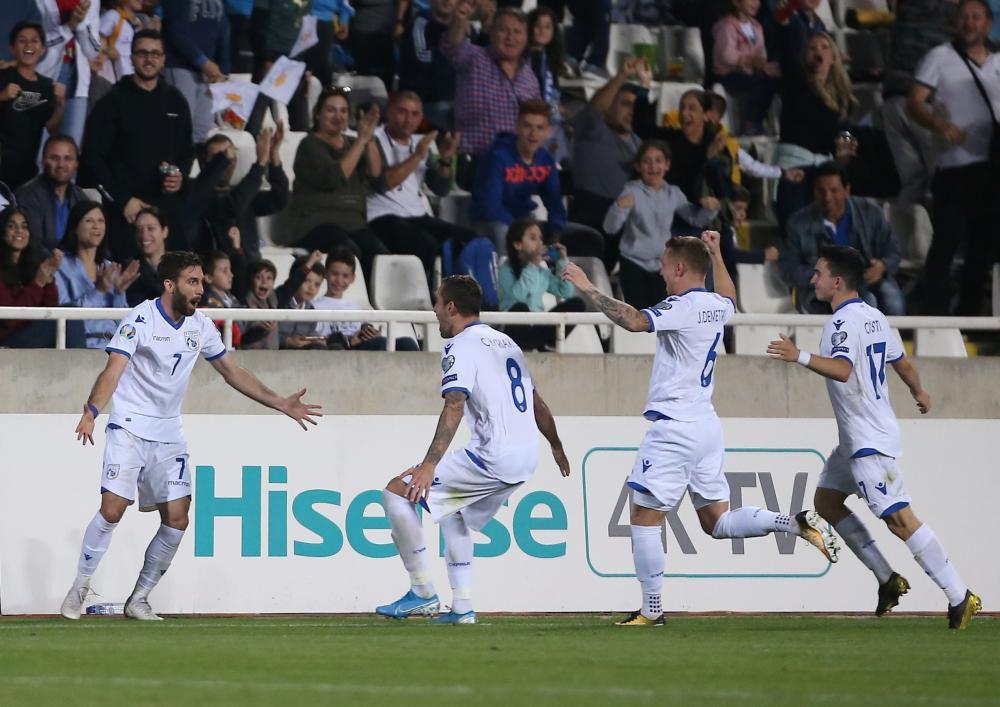 Cyprus' Georgios Efrem celebrates scoring the equaliser.