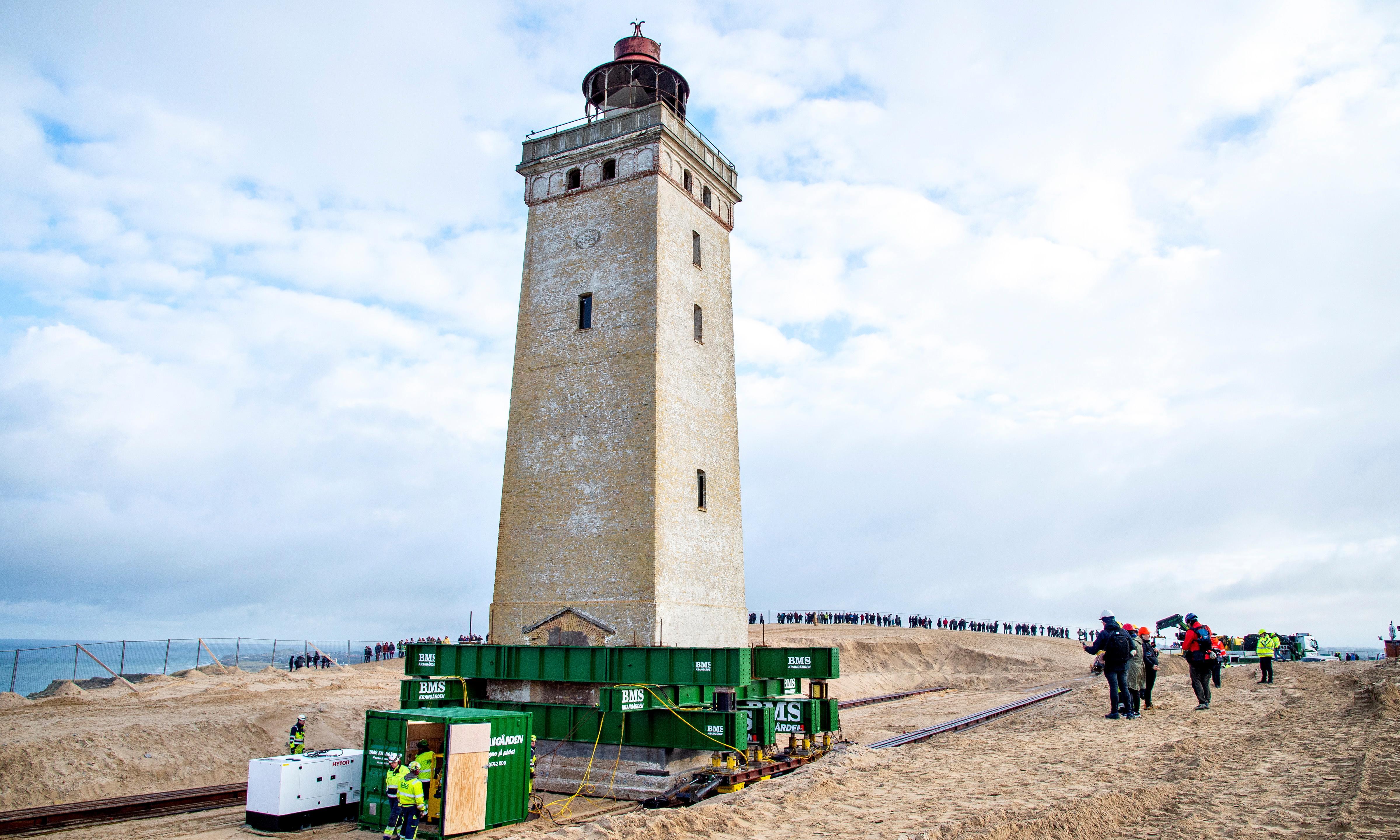 Danish lighthouse wheeled away from eroding coastline