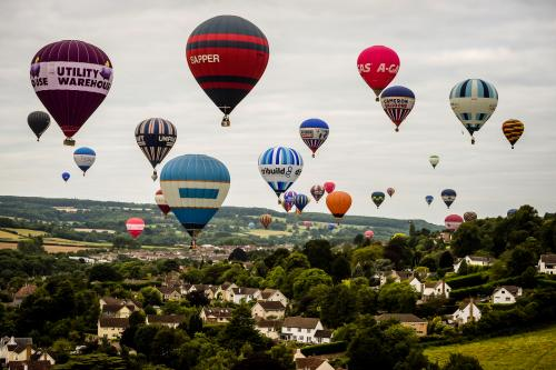 Hot-air balloons fly over the Ashton Court estate during the Bristol International Balloon Fiesta. The event, now in its 38th year, is Europe's largest balloon festival