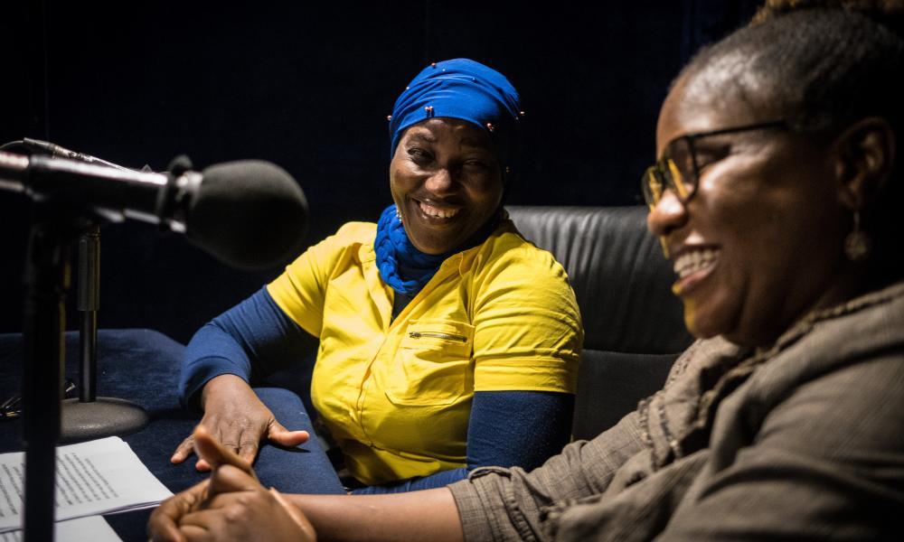 GSK Funded Projects - Sierra Leone 2019FREETOWN, SIERRA LEONE - OCTOBER 14 2019: The Lead Producer of BBC Media Action in Sierra Leone, Mariana Sesay (left) and radio presenter, Eastina Massaquoi (right) in the studio. BBC Media Action in Sierra Leone helps to improve access to information and enable nation-wide conversation about important topics such as malaria.