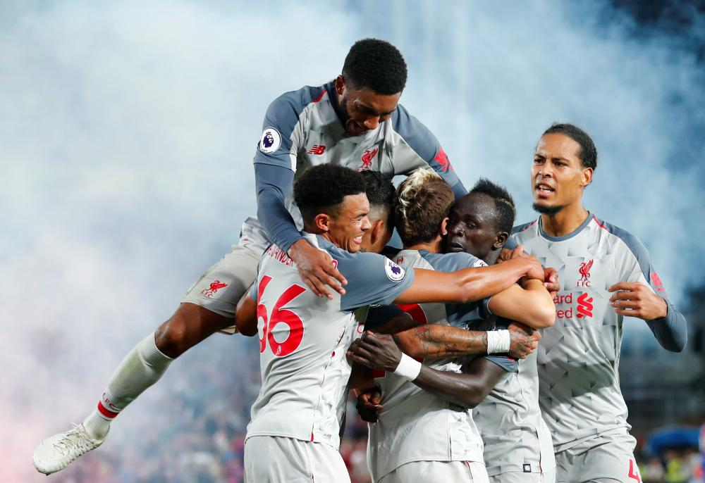 August 20: Liverpool's Sadio Mane celebrates scoring their second goal against Crystal Palace.