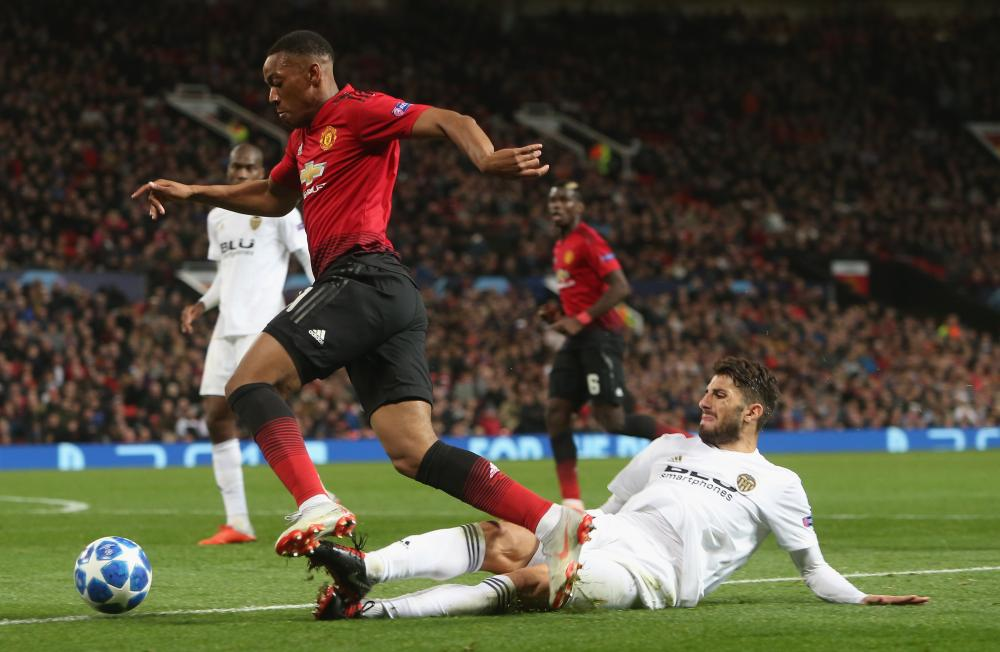 Anthony Martial is fouled by Cristiano Piccini.