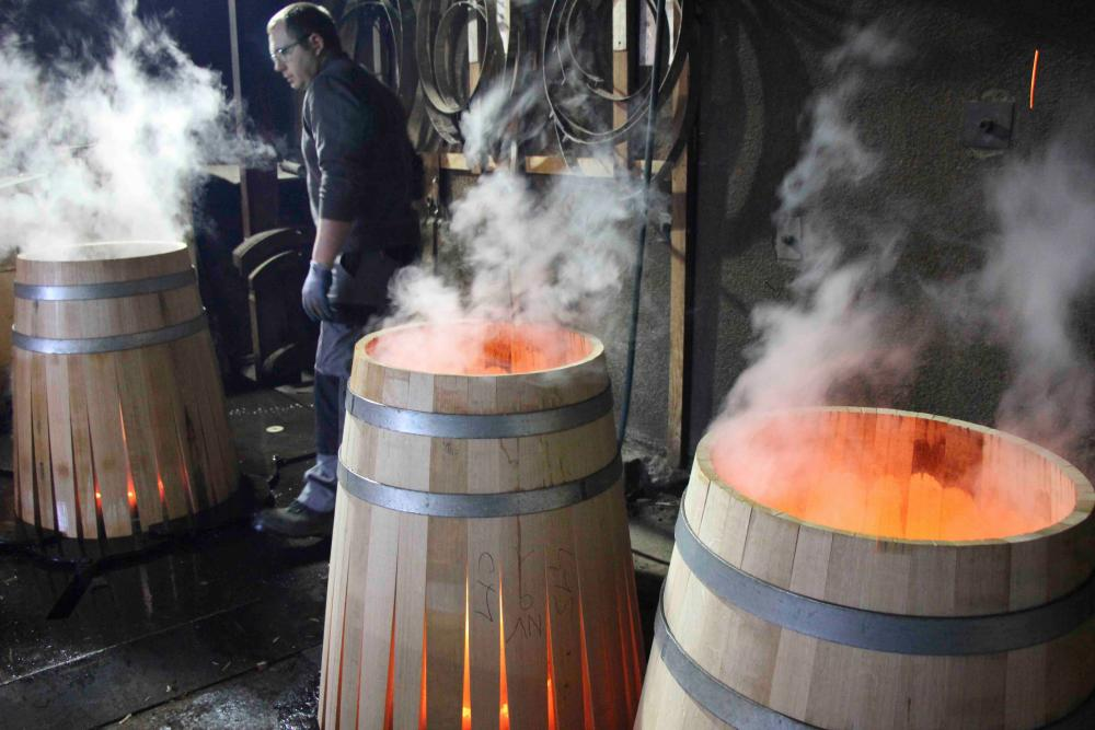 Toasting the inside of barrels at Allary.