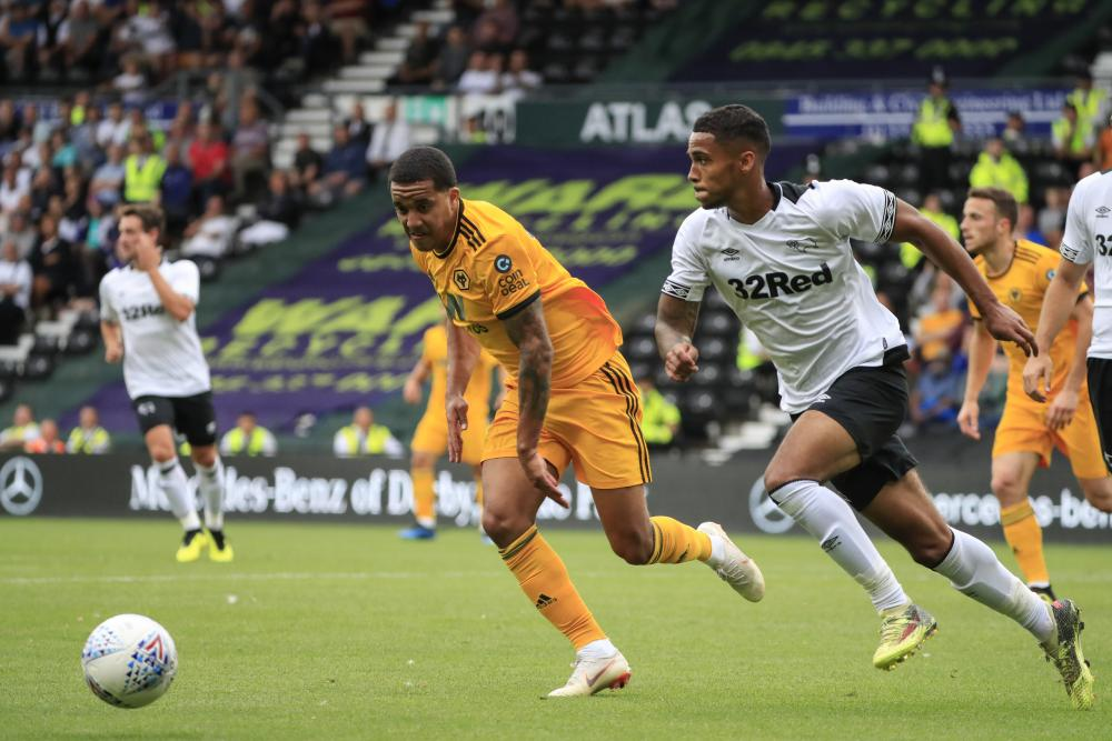 Max Lowe puts on the burners to go past Helder Costa of Wolves during a pre-season friendly.