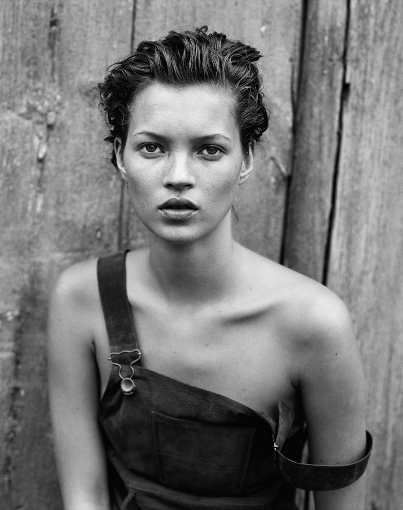 Kate Moss in dungarees with naked shoulders for Harper's Bazaar, 1994