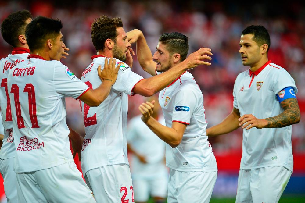 Sevilla forward Franco Vazquez celebrates after scoring a goal against Osasuna