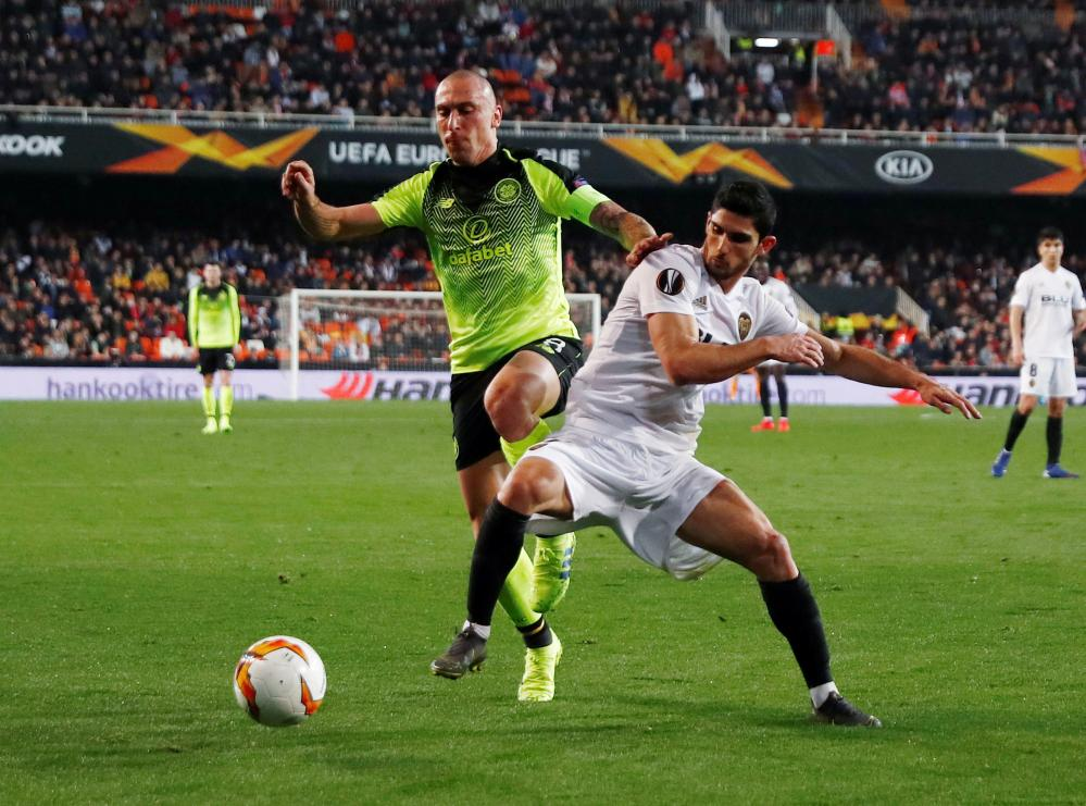 Valencia's Goncalo Guedes in action with Celtic's Scott Brown