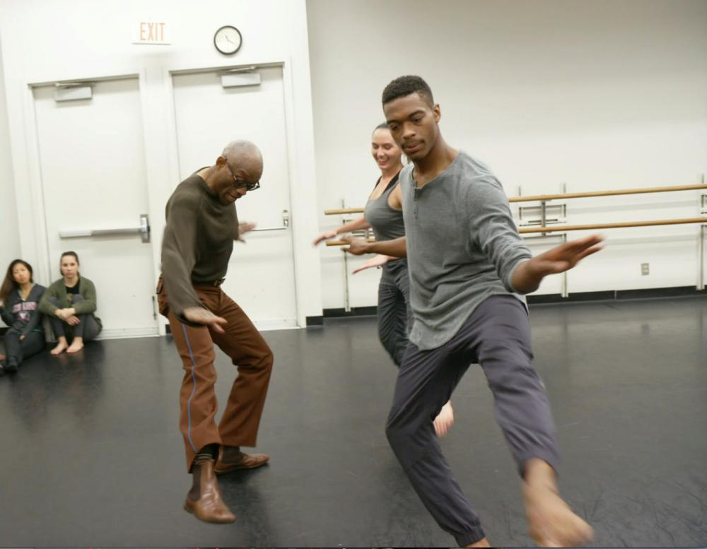 Bill T. Jones in rehearsal doing Astaire steps with students Brandon and Nicole