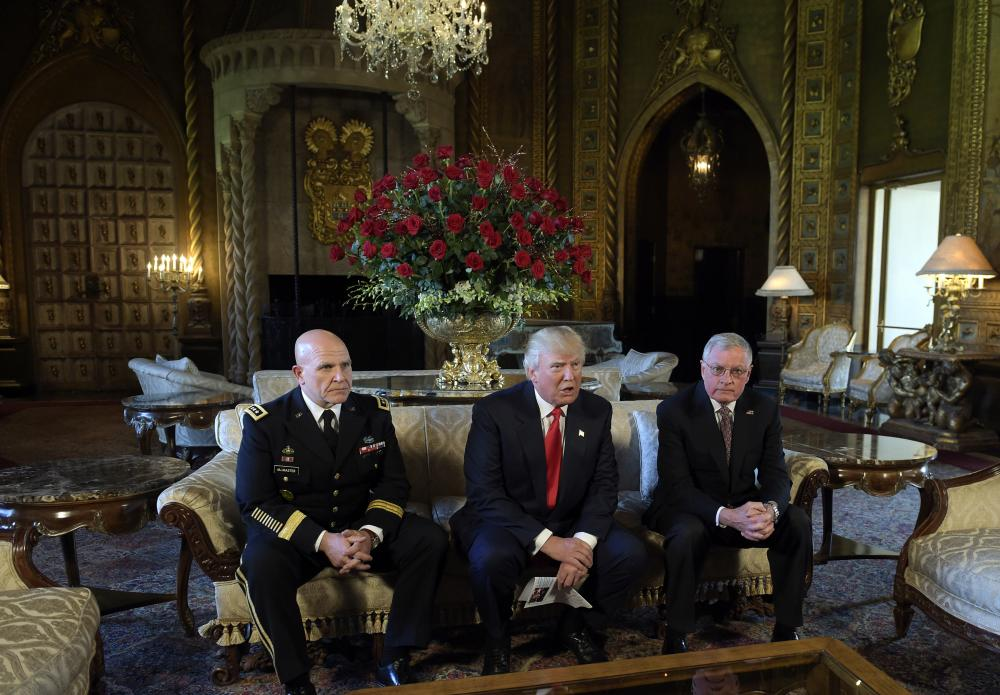 Business and pleasure ... Trump with his generals at Mar-a-Lago.