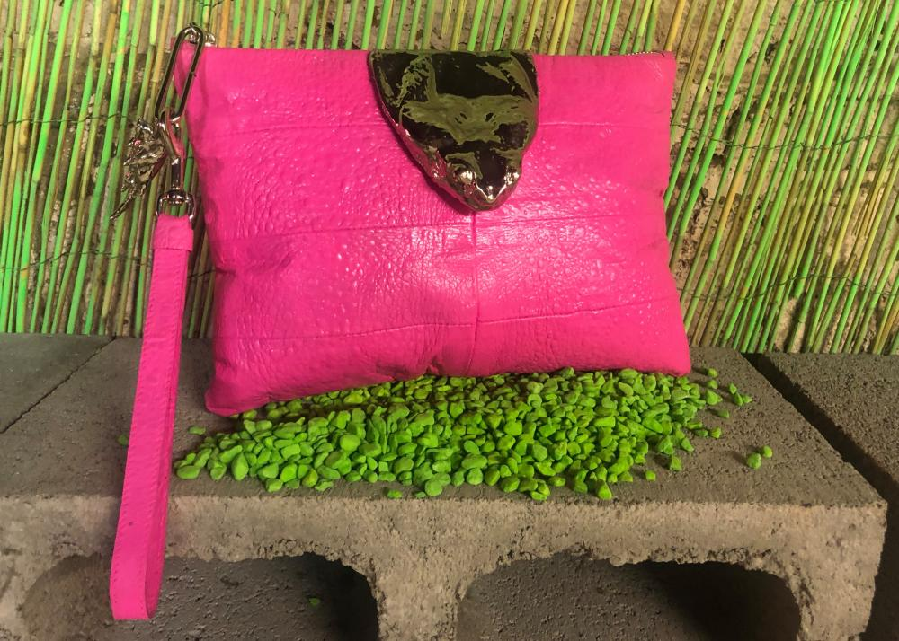 A bright pink cane toad purse from Vermin