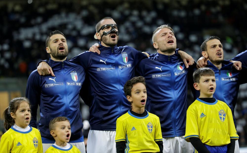 Leonardo Bonucci and Ciro Immobile sing a passionate national anthem.