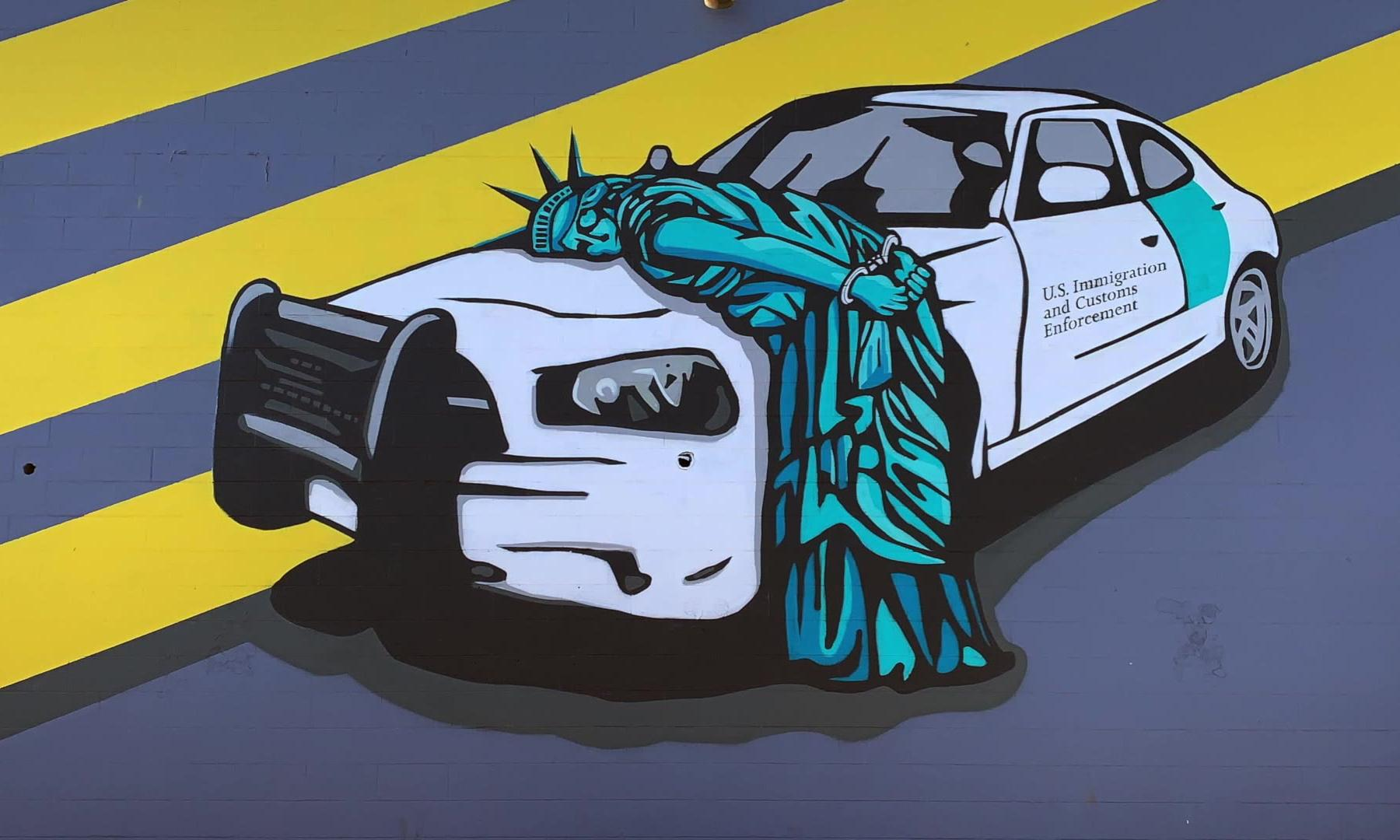 Statue of Liberty shown cuffed and arrested by immigration officials in new mural