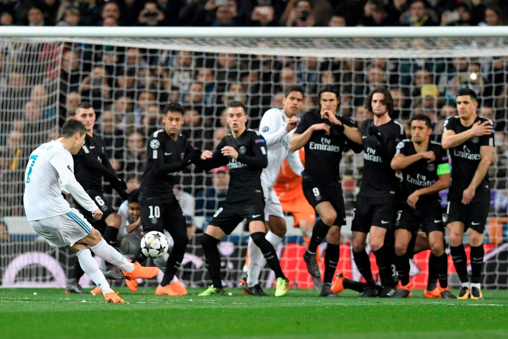 Ronaldo takes the free-kick.