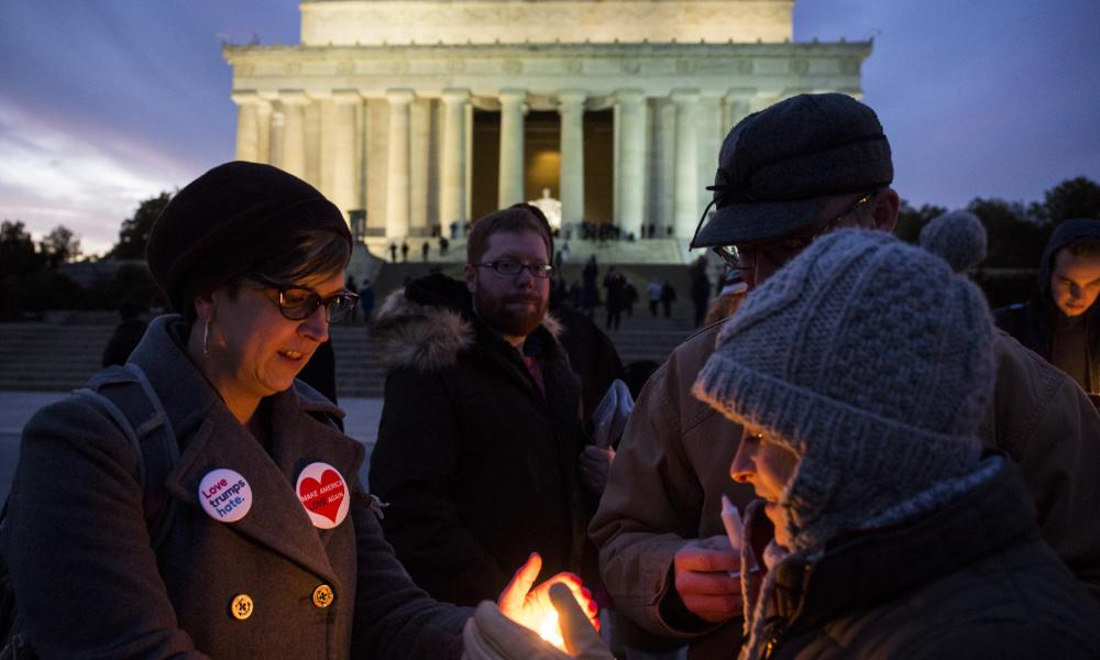 People hold candles during a vigil in front of the Lincoln Memorial this month in solidarity with protests against Donald Trump's travel ban.