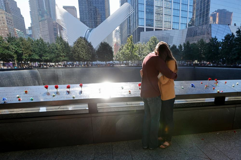 People mourn at the 9/11 Memorial on the 20th anniversary of the September 11 attacks, in Manhattan.