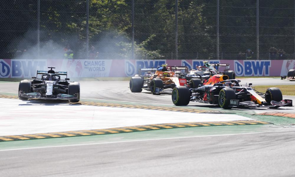 Lewis Hamilton , left, goes off the track
