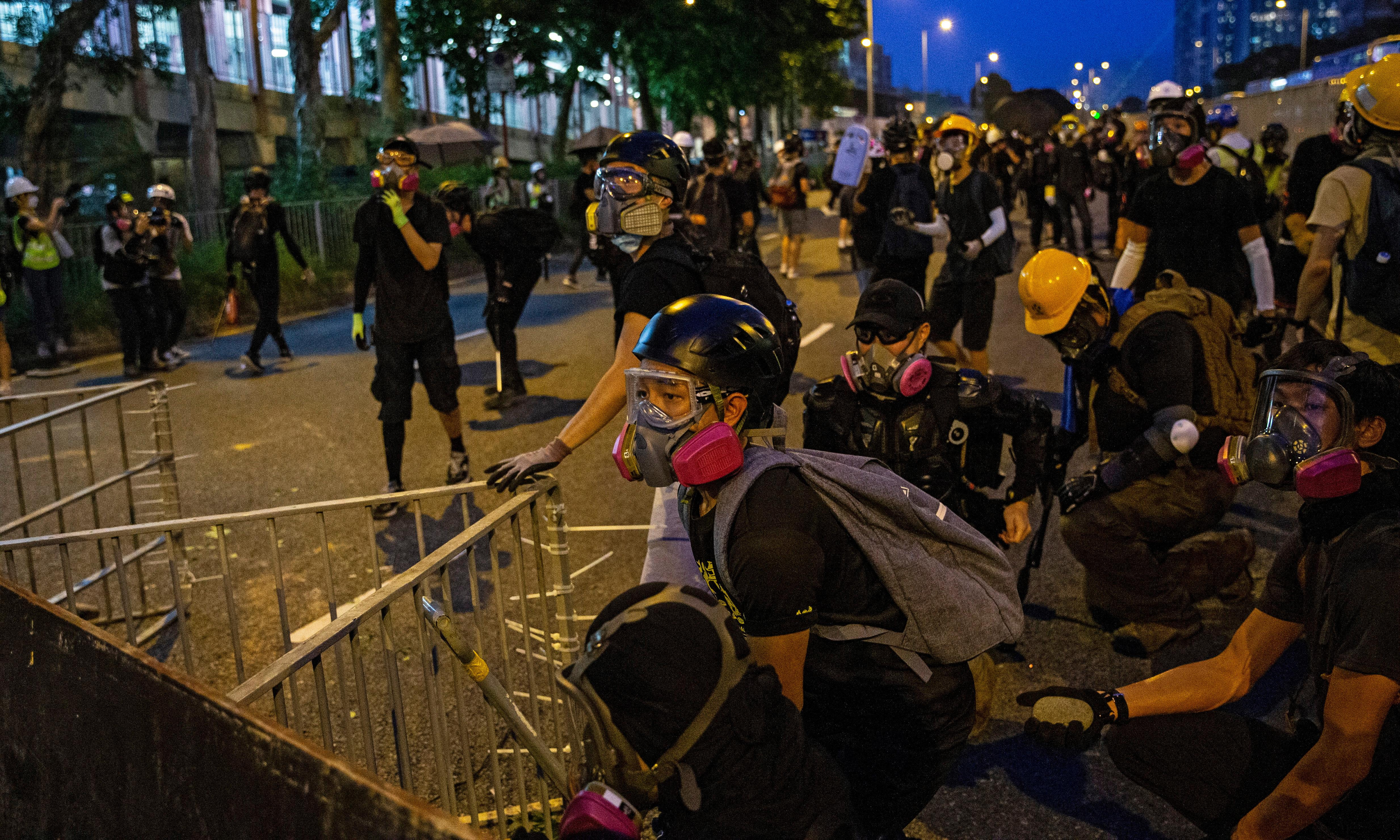Hong Kong riot police fire teargas at protest groups