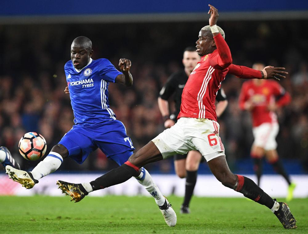 N'Golo Kante vies with Paul Pogba.