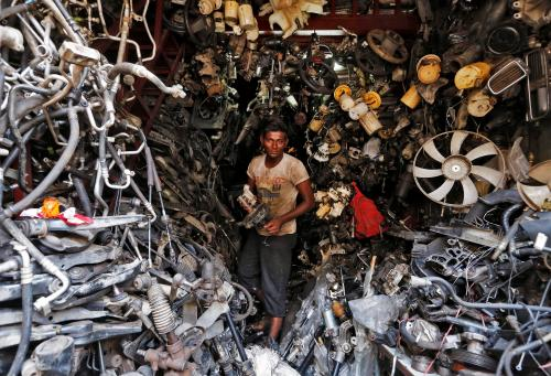 Fans, filters and fuel pumps among a mountain of car parts stripped down for reuse at a market
