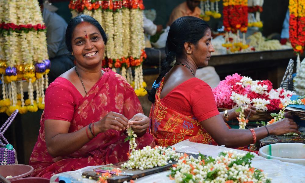 Workers at a flower stall in Devaraja market, Mysuru, India.