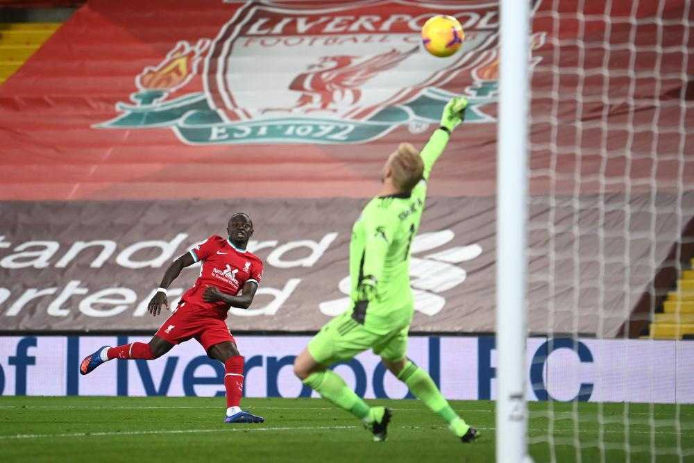 Kasper Schmeichel of Leicester City saves a shot from Sadio Mane of Liverpool.