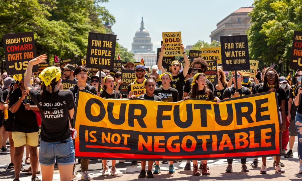 Protest demanding climate action and jobs, Pennsylvania Avenue NW, Washington, USA - 28 Jun 2021Mandatory Credit: Photo by Allison Bailey/REX/Shutterstock (12173478e) Hundreds of protesters march down Pennsylvania Avenue, en route to the White House. Protesters are young adults who are members of the Sunrise Movement. They have 3 demands of the Biden Administration: no compromises on climate with Congressional Republicans, a meeting with Sunrise Movement, and the creation of a Civilian Conservation Corps. Protest demanding climate action and jobs, Pennsylvania Avenue NW, Washington, USA - 28 Jun 2021