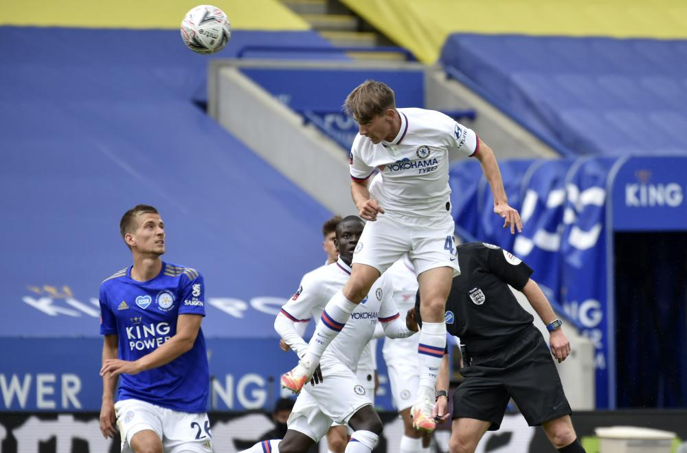 Chelsea's Billy Gilmour jumps for the ball