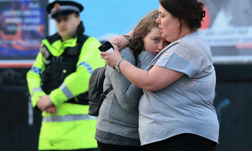 Vikki Baker and her thirteen year old daughter Charlotte hug outside the Manchester Arena stadium in Manchester