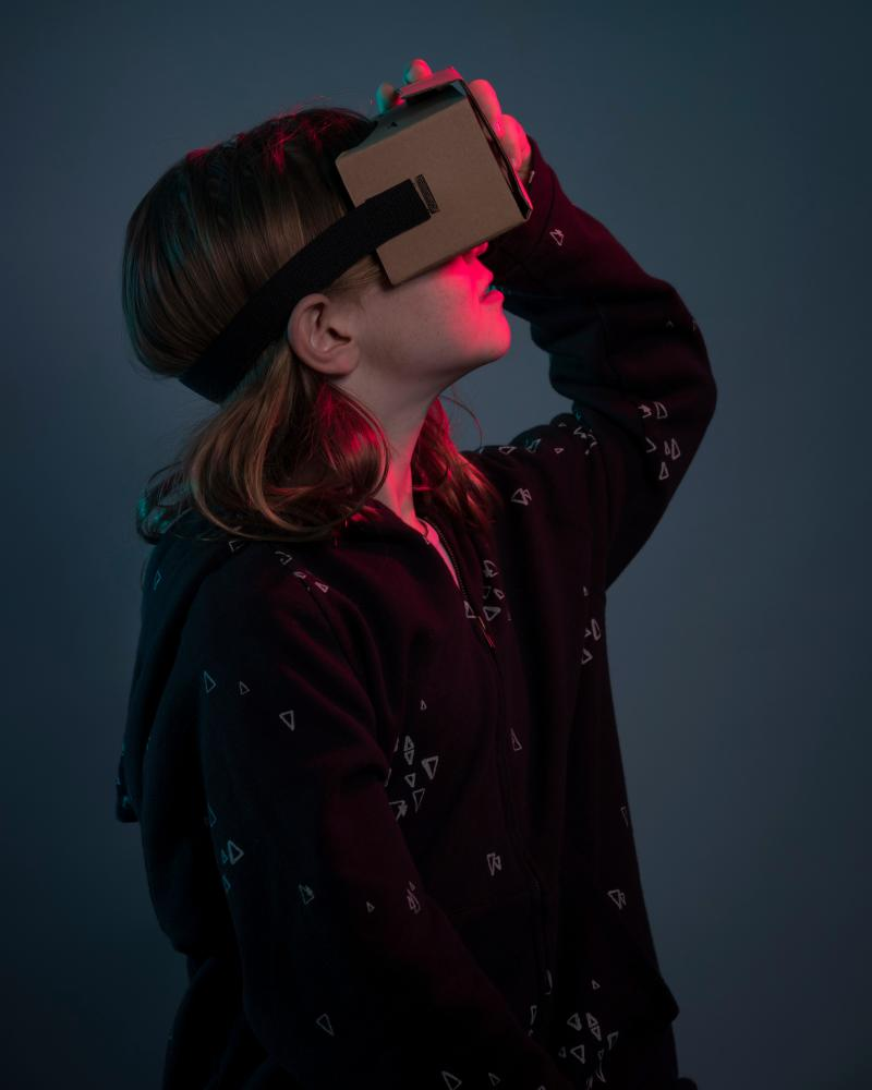 Girl using virtual reality headset.