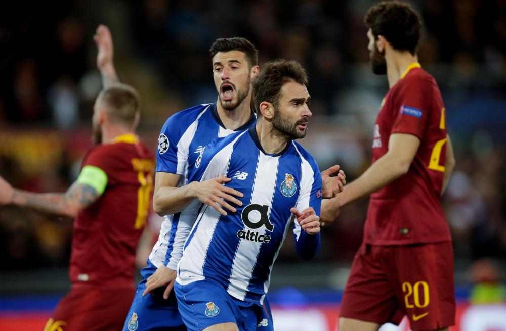 Adrian Lopez celebrates his away goal for Porto.