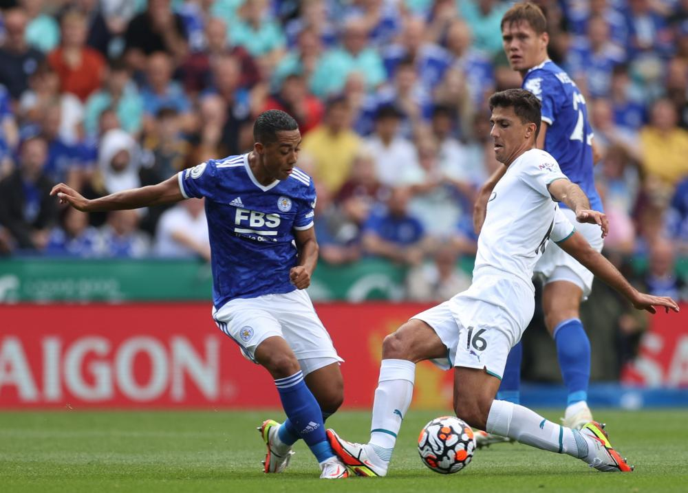 Manchester City's Rodri fouls Leicester City's Youri Tielemans.