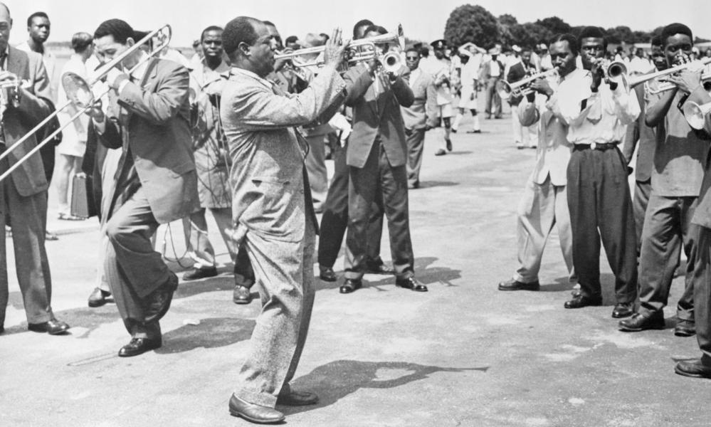 Louis Armstrong and his band band play for a crowd in Accra, then the capital of the Gold Coast.