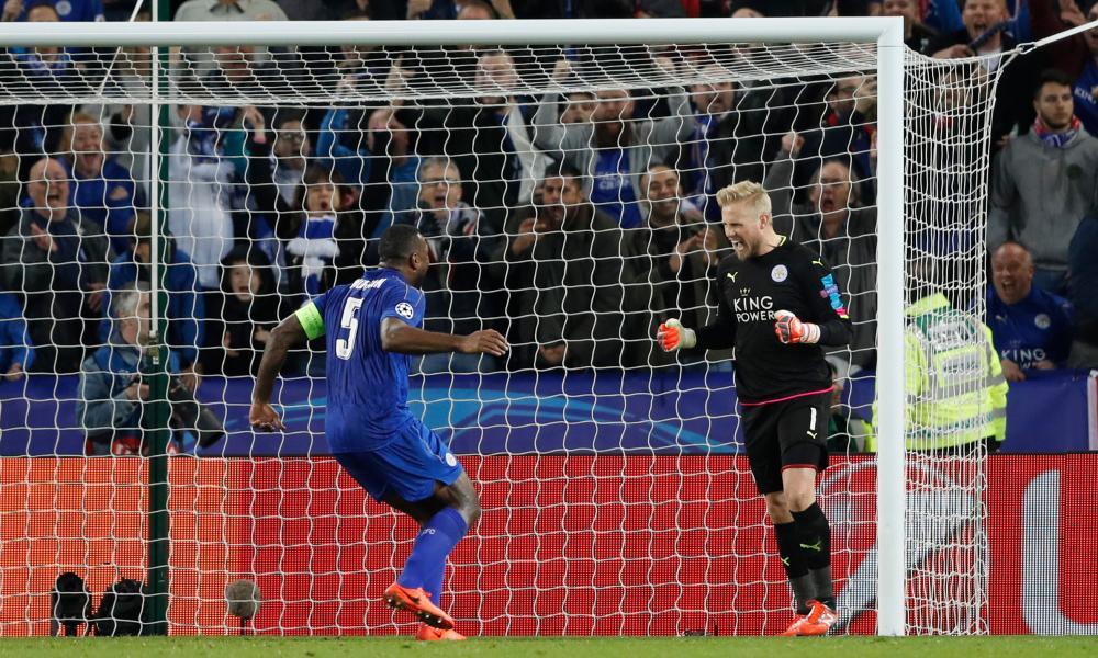 Kasper Schmeichel celebrates with Wes Morgan after his save.