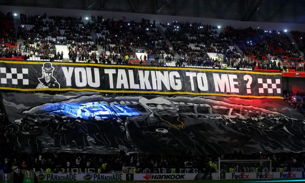 Supporters of Olympique Lyon show a banner
