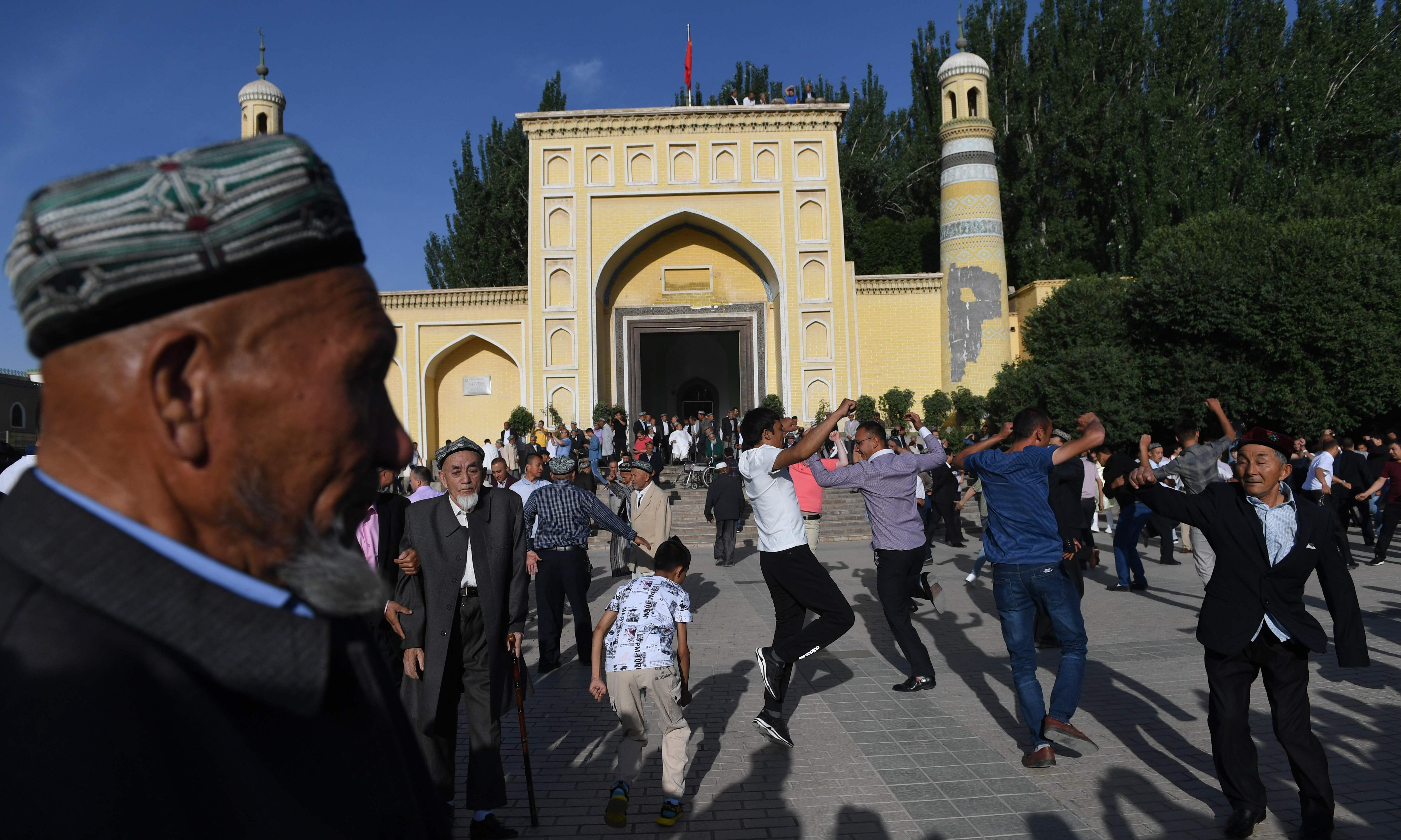 China denies Uighurs' Turkic descent and says 'hostile forces' trying to split country