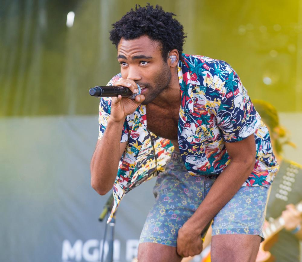 Rapper Childish Gambino performs on stage at the 2014 iHeartRadio Music Festival Village in Las Vegas