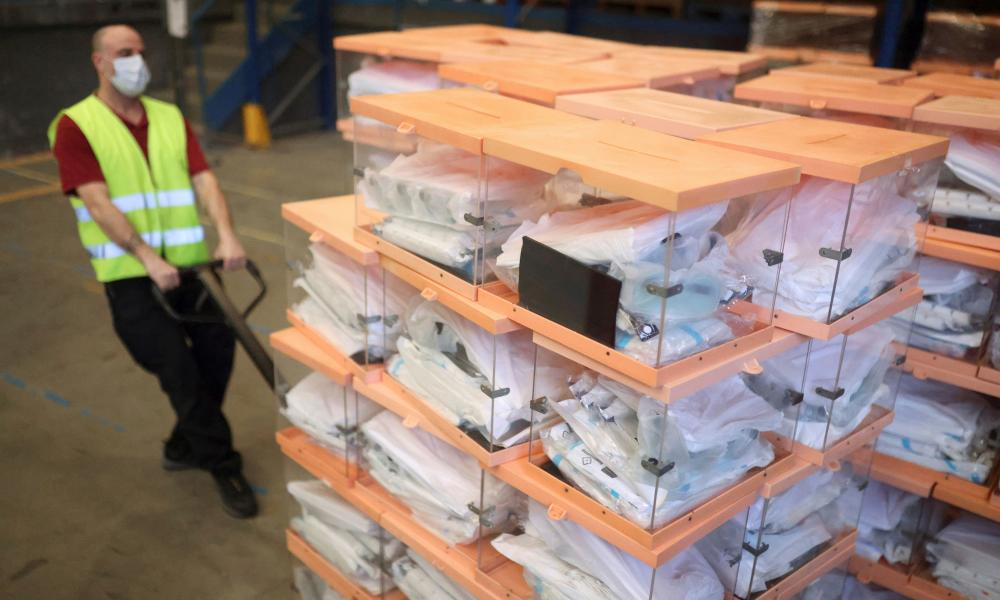 Catalonia unveils PPE for voting officials and ballot boxes ahead of regional election, in Barcelona.
