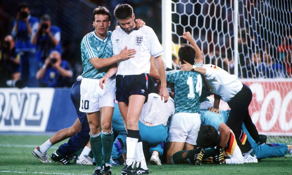 Chris Waddle is consoled by Lothar Matthäus after his miss in the 1990 World Cup semi-final penalty shootout.