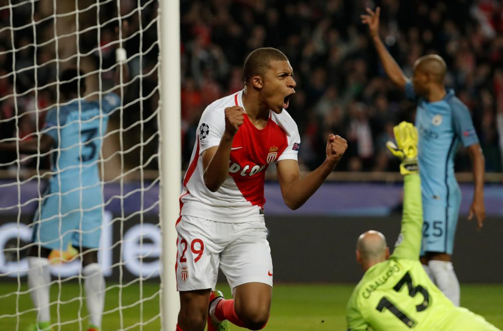 Monaco's Kylian Mbappe celebrates scoring their first goal